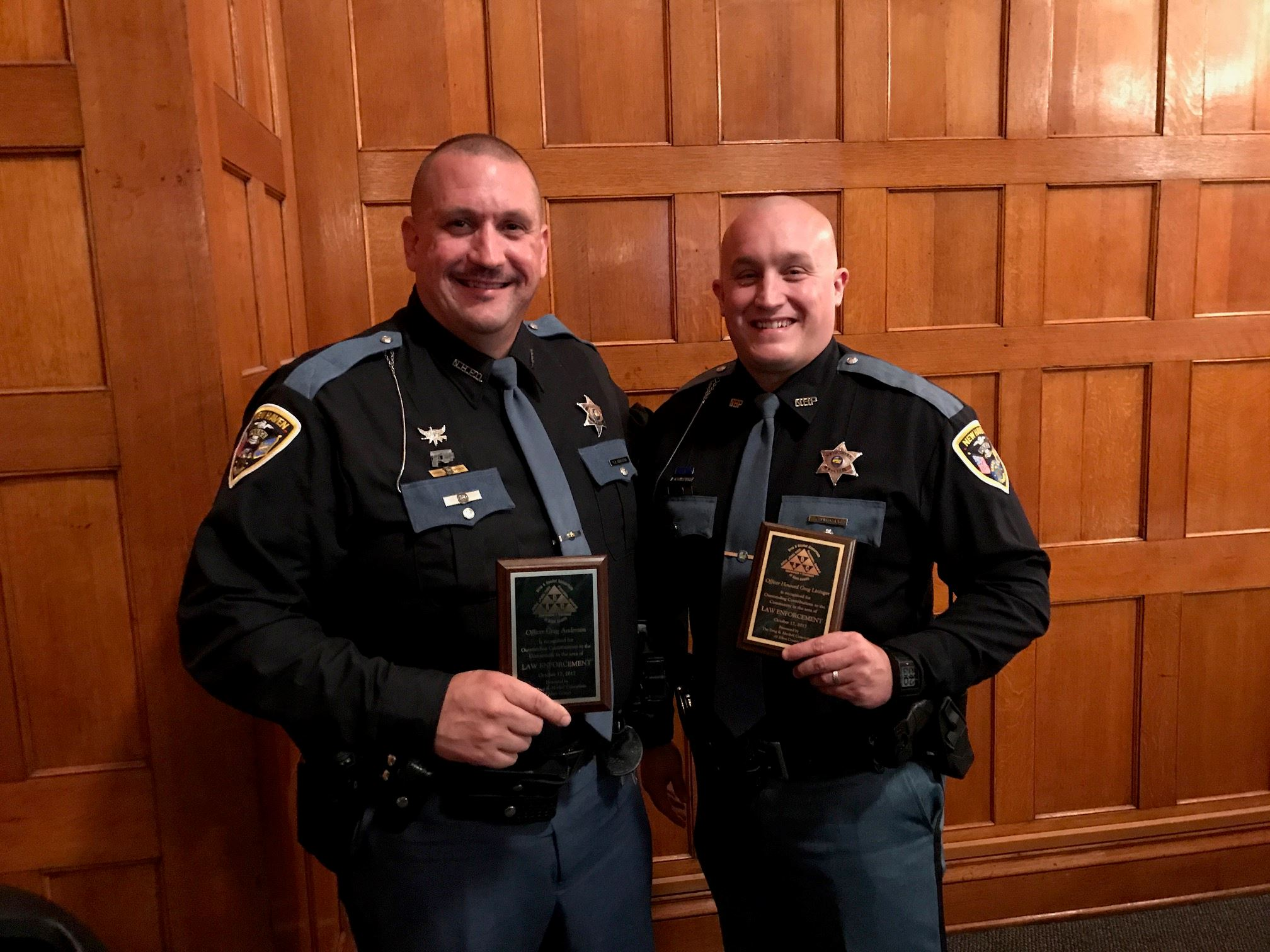 Officers Lininger and Anderson Receiving Awards