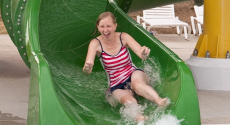 Woman rides water slide