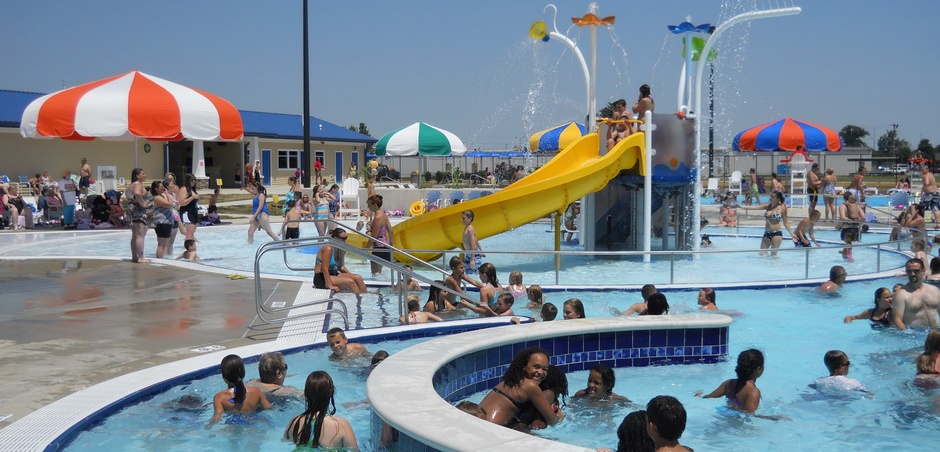 Water park with slide and crowds