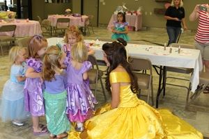 Girls dressed as princesses at party