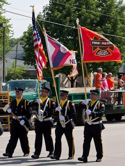 Honor Guard Marching in a Parade with Flags