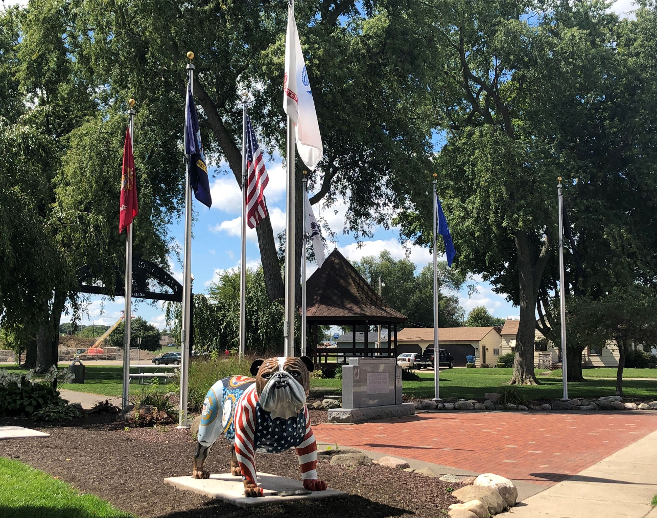 Dog statue and flags at Schnelker Park